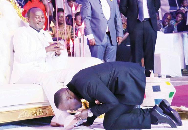 Weird photos as Ugandans start Prophet Mbonye's feet kissing Challenge – theinsider.ug